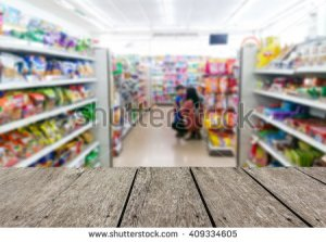 stock-photo-look-out-from-the-table-blur-image-of-inside-convenience-store-as-background-409334605